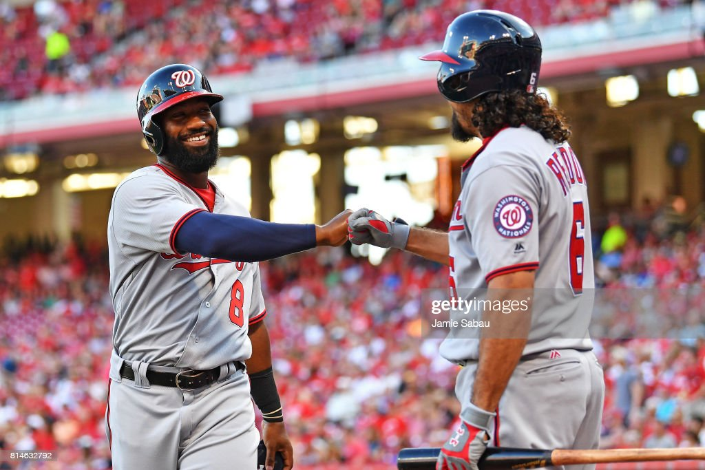 Brian Goodwin #8 of the Washington Nationals celebrates with Anthony Rendon #6 of the Washington Nationals after Goodwin scored the first run for the Nationals in the first inning against the Cincinnati Reds at Great American Ball Park on July 14, 2017 in Cincinnati, Ohio.