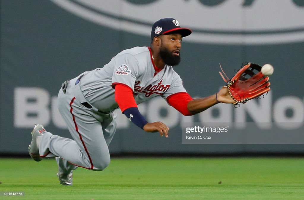 Brian Goodwin #8 of the Washington Nationals dives to catch a line out hit by Chris Stewart #8 of the Atlanta Braves to end the fourth inning at SunTrust Park on April 3, 2018 in Atlanta, Georgia.