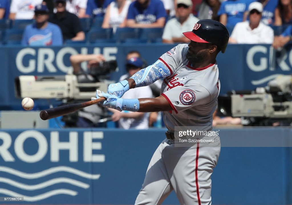 Brian Goodwin #8 of the Washington Nationals hits an RBI single in the eighth inning during MLB game action against the Toronto Blue Jays at Rogers Centre on June 17, 2018 in Toronto, Canada.