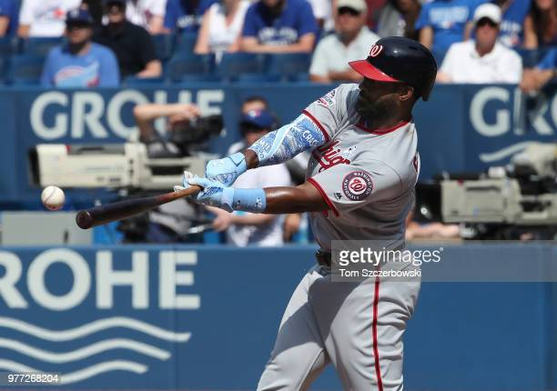 Brian Goodwin of the Washington Nationals hits an RBI single in the eighth inning during MLB game action against the Toronto Blue Jays at Rogers...