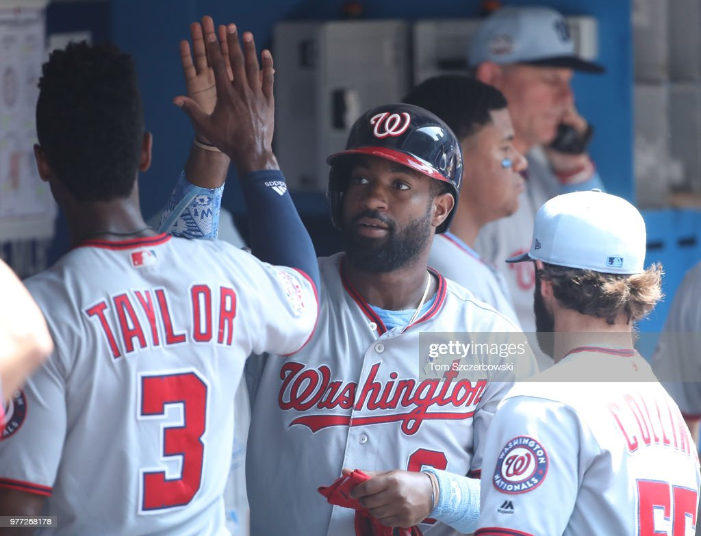 Brian Goodwin #8 of the Washington Nationals is congratulated by teammates in the dugout after scoring a run in the sixth inning during MLB game action against the Toronto Blue Jays at Rogers Centre on June 17, 2018 in Toronto, Canada.