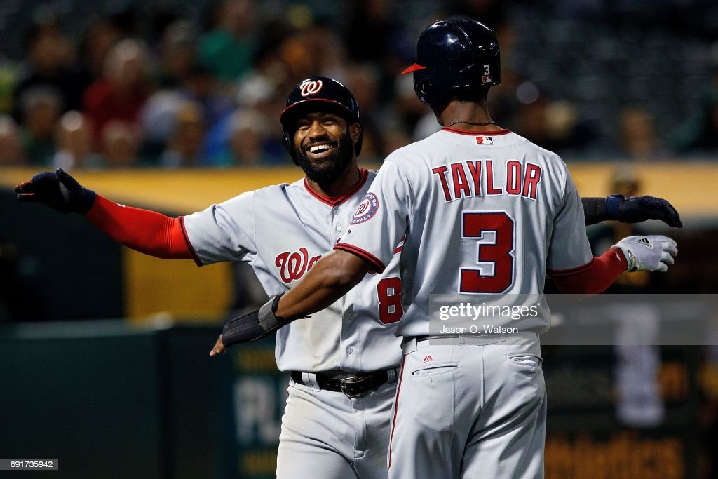 Brian Goodwin #8 of the Washington Nationals is congratulated by Michael Taylor #3 after hitting a home run against the Oakland Athletics during the seventh inning at the Oakland Coliseum on June 2, 2017 in Oakland, California. The Washington Nationals defeated the Oakland Athletics 13-3.