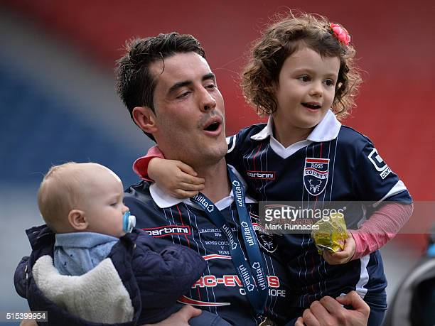 Brian Graham of Ross County celebrates winning the League Cup with his children as Ross County beat Hibernian 2-1 during the Scottish League Cup...