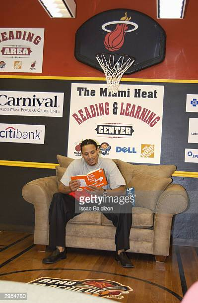 Brian Grant of the Miami Heat reads Green Eggs and Ham to children during the opening of a new Read to Achieve Center at Paul Laurence Dunbar...