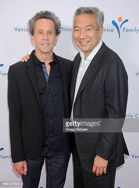 Brian Grazer and Kevin Tsujihara Chairman and Chief Executive Officer of Warner Bros arrive at Venice Family Clinic's 33rd Annual Silver Circle Gala...
