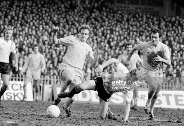 Brian Greenhoff of Manchester United clashes with Phil Thompson of Liverpool watched by Ray Kennedy of Liverpool during the FA Cup SemiFinal at Maine...