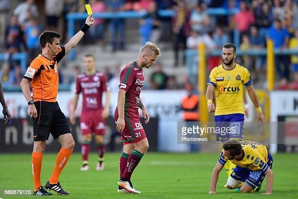 Brian Hamalainen defender of SV Zulte Waregem receives a yellow card from referee Lambrechts during the Jupiler Pro League match between Waasland -...