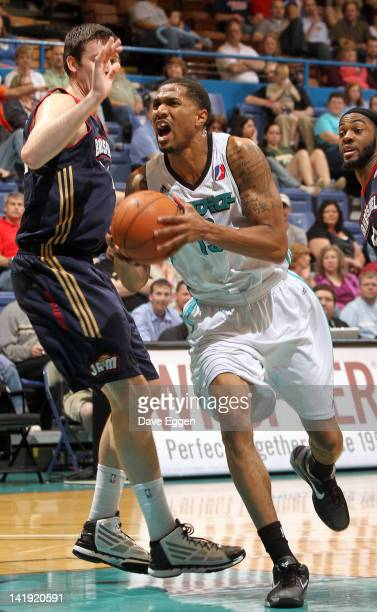 Brian Hamilton from the Sioux Falls Skyforce drives to the basket against Adam Koch from the Bakersfield Jam in the second half of their NBA DLeague...