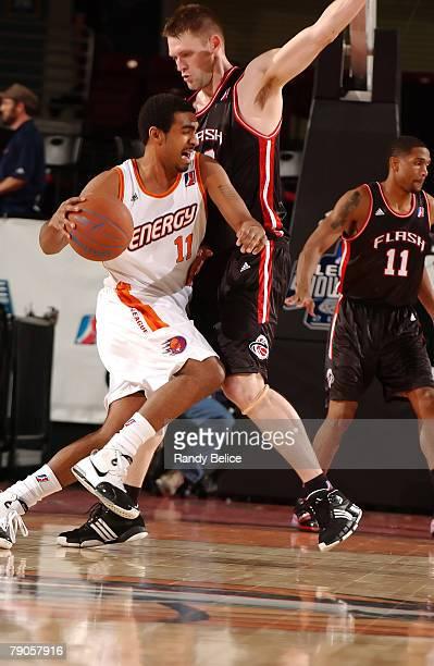 Brian Hamilton of the Iowa Energy drives on Brian Jackson of the Utah Flash during the 2008 NBA Development League Showcase game between the Utah...