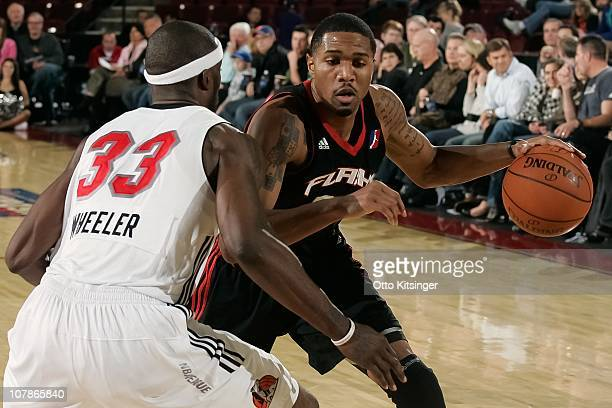 Brian Hamilton of the Utah Flash controls the ball against Carlos Wheeler of the Idaho Stampede during a game on December 11 2010 at Qwest Arena in...