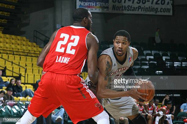 Brian Hamilton of the Utah Flash looks to make his move against Stephane Lasme of the Maine Red Claws at McKay Events Center on March 22 2011 in Orem...