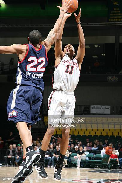 Brian Hamilton of the Utah Flash puts the shot up over Scooter McFadgon of the Bakersfield Jam on January 04 2008 at the David O McKay Events Center...