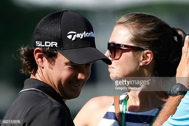 Brian Harman celebrates with his fiance Kelly Van Slyke after winning the John Deere Classic held at TPC Deere Run on July 13 2014 in Silvis Illinois