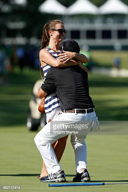 Brian Harman embraces his fiance Kelly Van Slyke after winning the John Deere Classic held at TPC Deere Run on July 13 2014 in Silvis Illinois