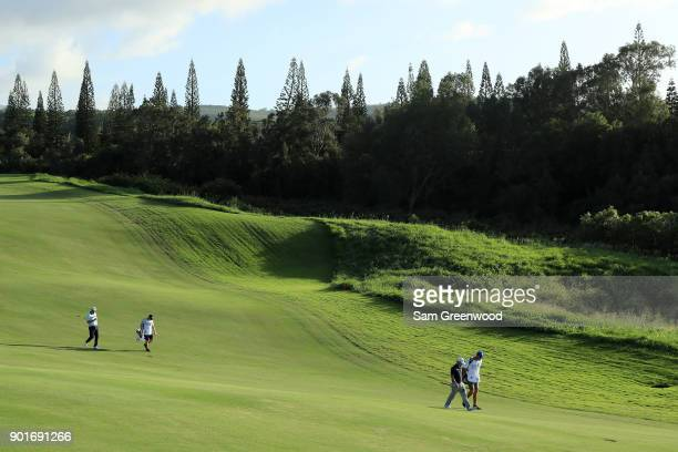 Brian Harman of the United States and Marc Leishman of Australia walk on the 18th hole during the second round of the Sentry Tournament of Champions...