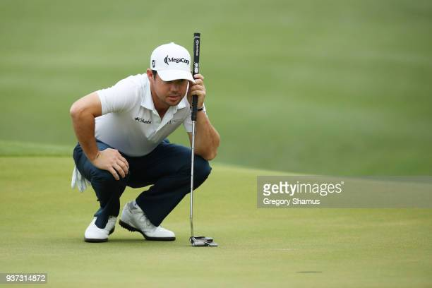 Brian Harman of the United States lines up a putt on the fifth green during the fourth round of the World Golf ChampionshipsDell Match Play at Austin...