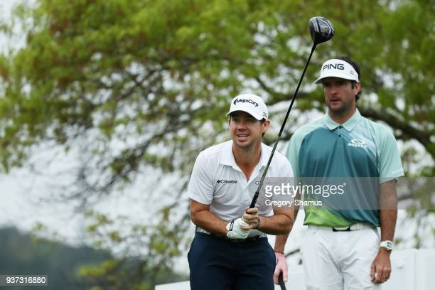 Brian Harman of the United States plays his shot from the sixth tee as Bubba Watson of the United States looks on during the fourth round of the...