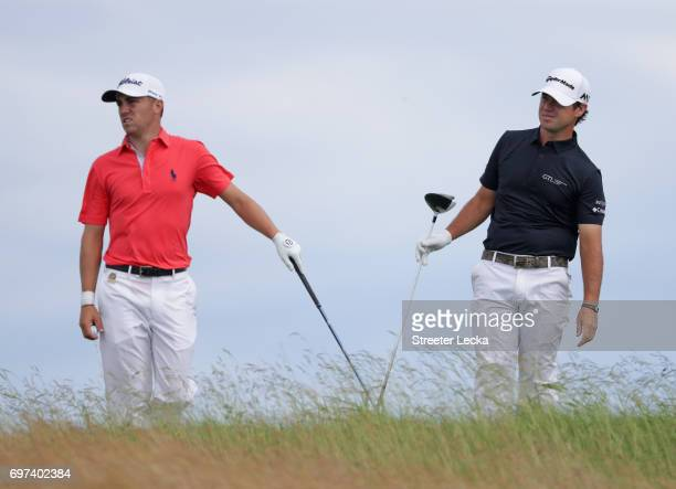 Brian Harman of the United States plays his shot from the tenth tee as Justin Thomas of the United States looks on during the final round of the 2017...