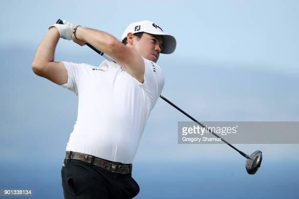 Brian Harman of the United States plays his shot from the tenth tee during the first round of the Sentry Tournament of Champions at Plantation Course...