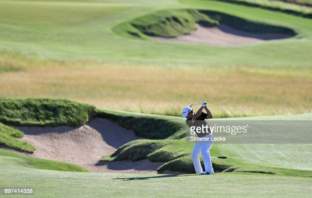 Brian Harman of the United States plays his shot on the 14th hole during the final round of the 2017 US Open at Erin Hills on June 18 2017 in...