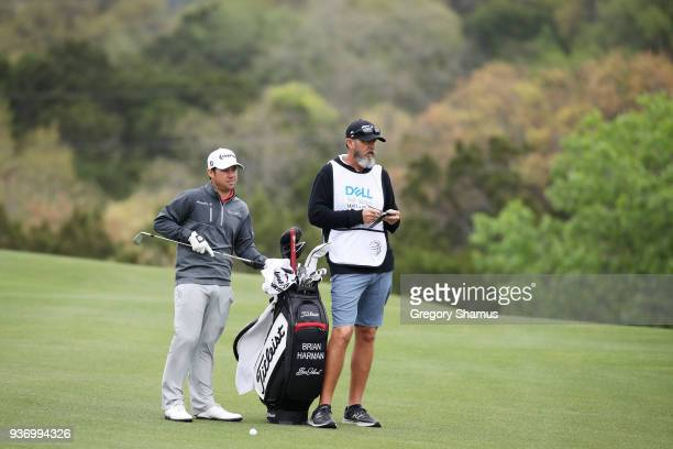 Brian Harman of the United States pulls a club from his bag as he prepares to play a shot on the first hole during the third round of the World Golf...