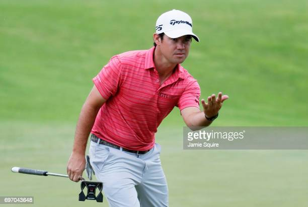 Brian Harman of the United States reacts after a putt on the 16th green during the third round of the 2017 US Open at Erin Hills on June 17 2017 in...