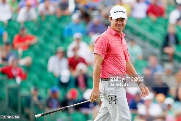 Brian Harman of the United States smiles on the 18th green during the third round of the 2017 US Open at Erin Hills on June 17 2017 in Hartford...