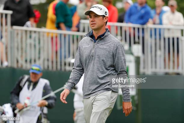Brian Harman of the United States walks off the first tee during the Third Round of the Travelers Championship on June 23 at TPC River Highlands in...