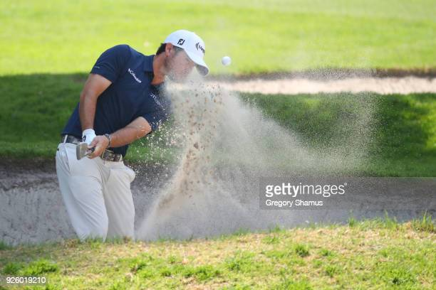 Brian Harman plays a shot for a sand trap on the first hole during the first round of World Golf ChampionshipsMexico Championship at Club de Golf...