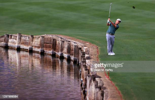 Brian Harman plays his shot on the fourth hole during the third round of The American Express tournament on the Stadium course at PGA West on January...