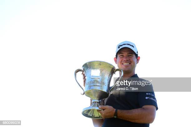 Brian Harman poses with the trophy after winning the Wells Fargo Championship at Eagle Point Golf Club on May 7 2017 in Wilmington North Carolina