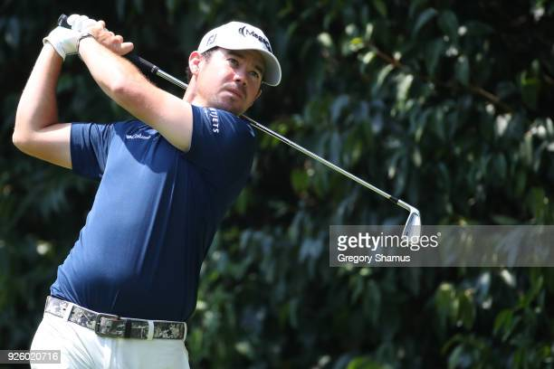 Brian Harman watches his tee shot on the second hole during the first round of World Golf ChampionshipsMexico Championship at Club de Golf...