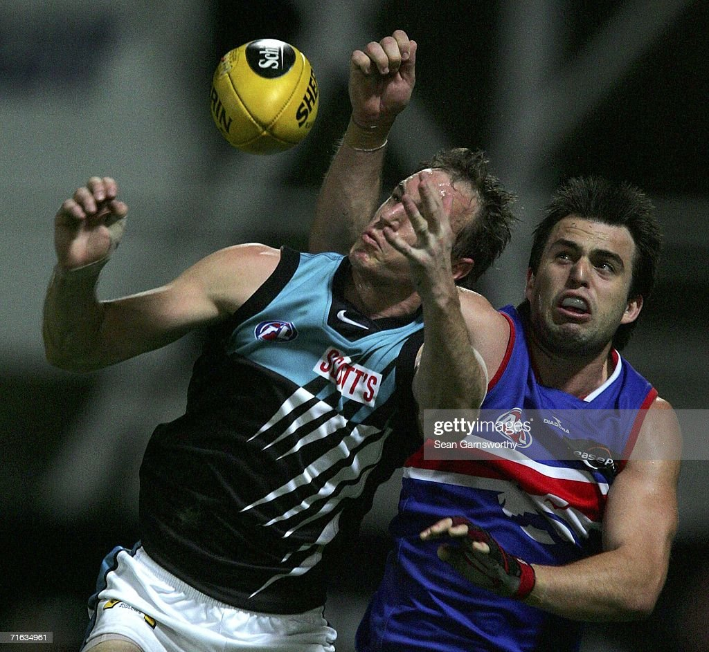 Brian Harris #36 for the Bulldogs and Toby Thurstans #28 for the Power in action during the round 19 AFL match between the Western Bulldogs and the Port Adelaide Power at Marrara Oval on August 12, 2006 in Darwin, Australia.