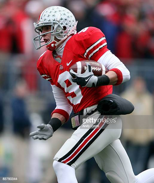 Brian Hartline of the Ohio State Buckeyes catches a pass for a touchdown during the Big Ten Conference game against the Michigan Wolverines at Ohio...