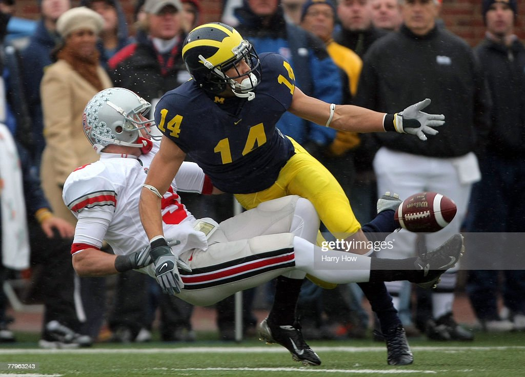 Brian Hartline #9 of the Ohio State Buckeyes collides with Trent Morgan #14 of the Michigan Wolverines as they try for a pass during the first quarter at Michigan Stadium on November 17, 2007 in Ann Arbor, Michigan. The Buckeyes won 14-3.