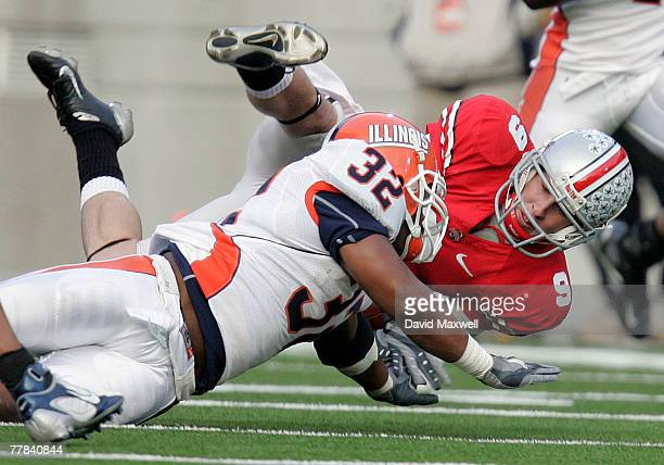 Brian Hartline of the Ohio State Buckeyes is tackled by Justin Harrison of the Illinois Fighting Illini during the first quarter at Ohio Stadium...
