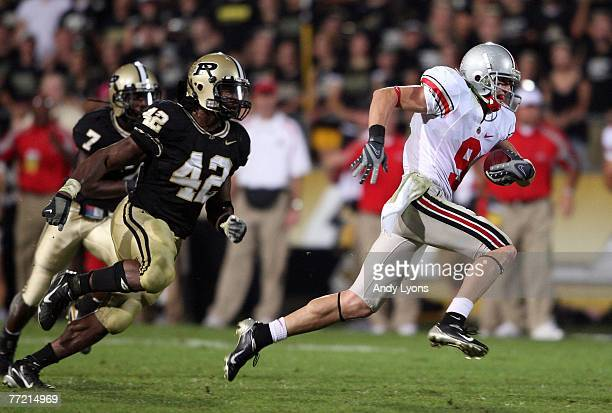Brian Hartline of the Ohio State Buckeyes runs away from Anthony Heygood of the Purdue Boilermakers during the game on October 6, 2007 at Ross-Ade...
