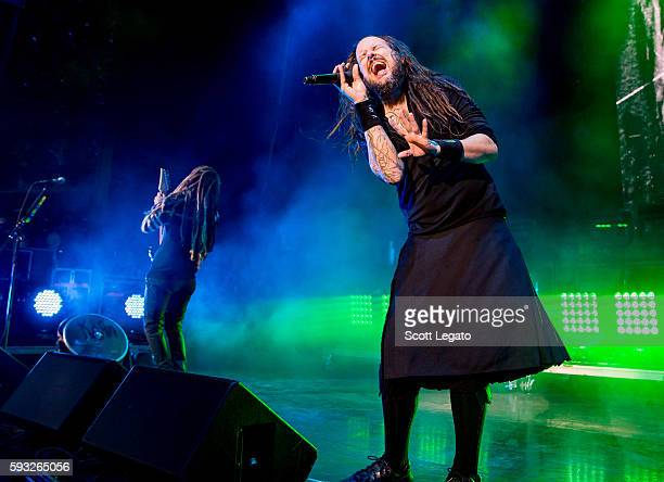 Brian 'Head' Welch and Jonathan Davis of KORN perform at DTE Energy Music Theater on August 21 2016 in Clarkston Michigan