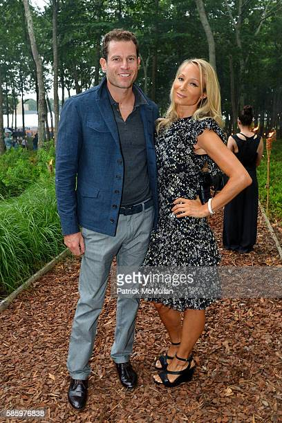Brian Henderson and Indira Cesarine attend The 23rd Annual Watermill Center Summer Benefit Auction at The Watermill Center on July 30 2016 in Water...
