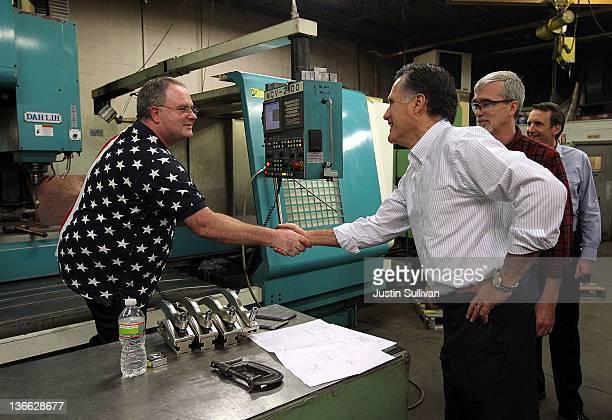 Brian Henderson greets Republican presidential candidate former Massachusetts Gov Mitt Romney Jack Gilchrist and former Minnesota Gov Tim Pawlenty...
