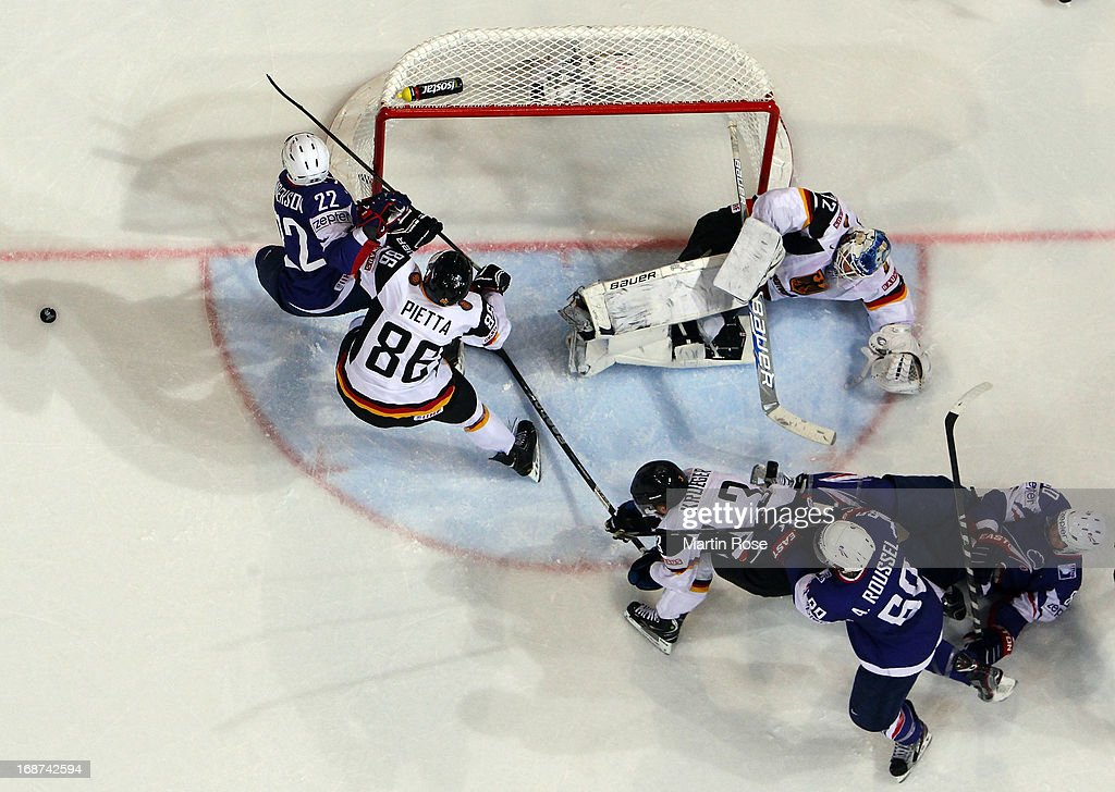 Brian Henderson (#22) of France fails to score over Rob Zepp (L), goaltender of Germany during the IIHF World Championship group H match between France and Germany at Hartwall Areena on May 14, 2013 in Helsinki, Finland.