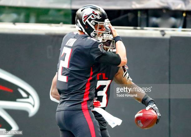 Brian Hill celebrates his touchdown with Matt Ryan of the Atlanta Falcons during the second quarter of an NFL game against the Chicago Bears at...