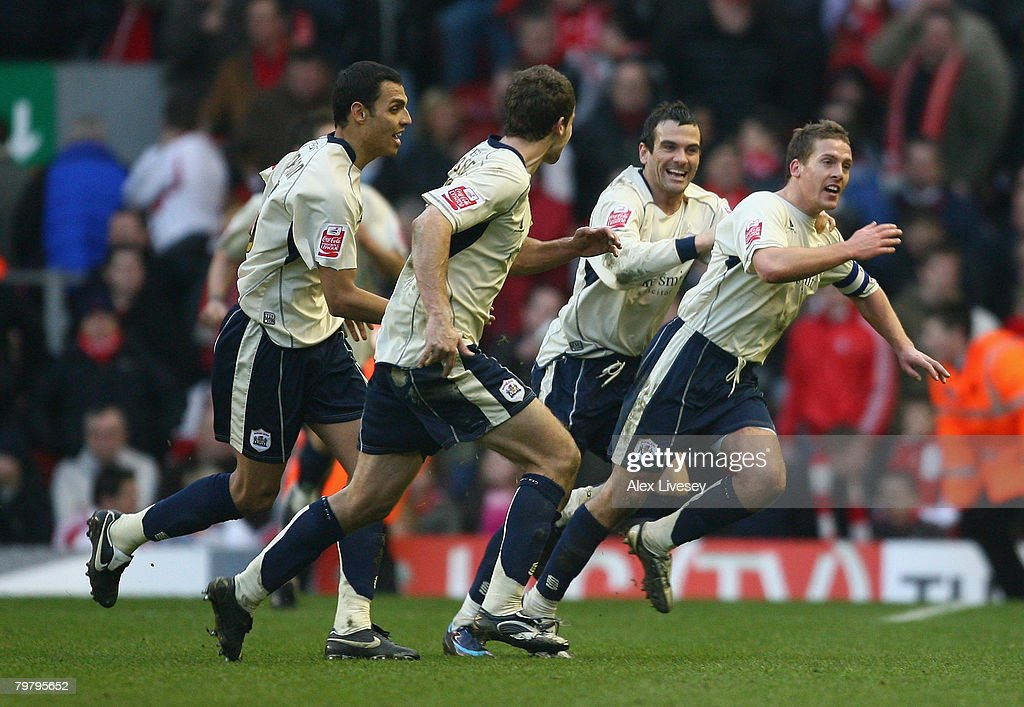 Brian Howard (R) of Barnsley celebrates with his team mates after scoring the winning goal during the FA Cup sponsored by E.on Fifth Round match between Liverpool and Barnsley at Anfield on February 16, 2008 in Liverpool, England.