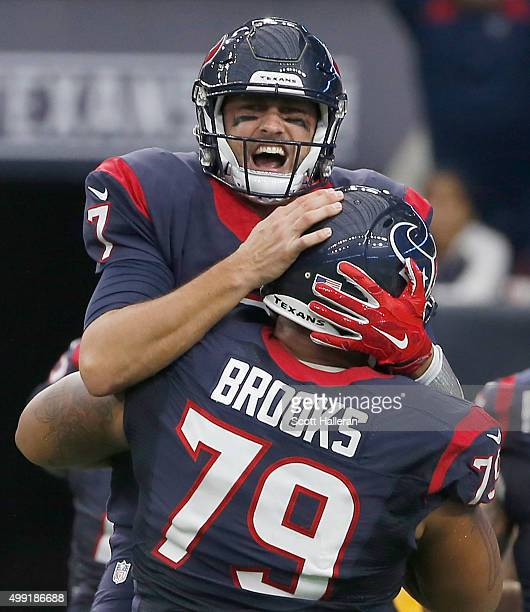 Brian Hoyer and Brandon Brooks of the Houston Texans celebrates a touchdown against the New Orleans Saints in the third quarter on November 29 2015...