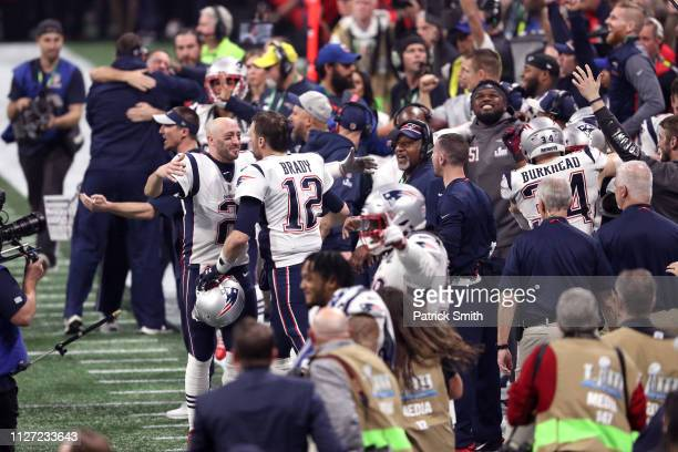 Brian Hoyer and Tom Brady of the New England Patriots celebrate their teams 133 win over the Los Angeles Rams during Super Bowl LIII at MercedesBenz...