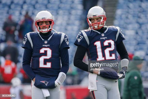 Brian Hoyer and Tom Brady of the New England Patriots look on before the game against the New York Jets at Gillette Stadium on December 31 2017 in...