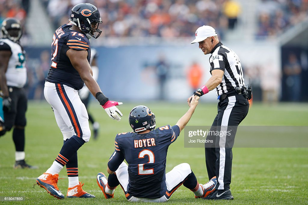 Brian Hoyer #2 of the Chicago Bears is helped up by referee Clete Blakeman after being knocked down against the Jacksonville Jaguars in the first half of the game at Soldier Field on October 16, 2016 in Chicago, Illinois. The Jaguars defeated the Bears 17-16.