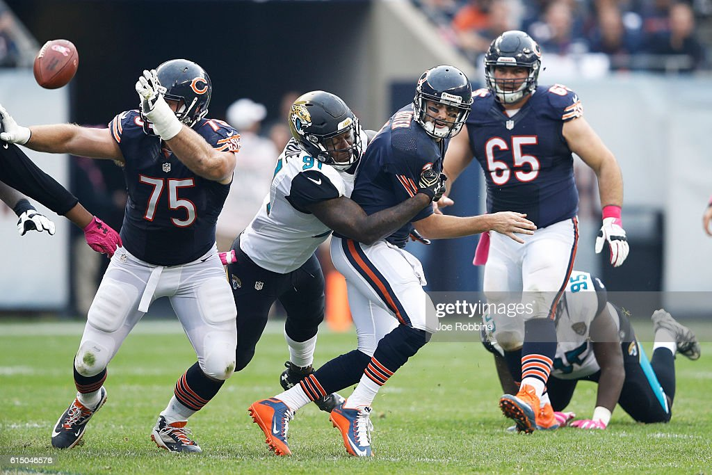 Brian Hoyer #2 of the Chicago Bears loses the ball after being hit by Yannick Ngakoue #91 of the Jacksonville Jaguars in the second half of the game at Soldier Field on October 16, 2016 in Chicago, Illinois. The Jaguars defeated the Bears 17-16.