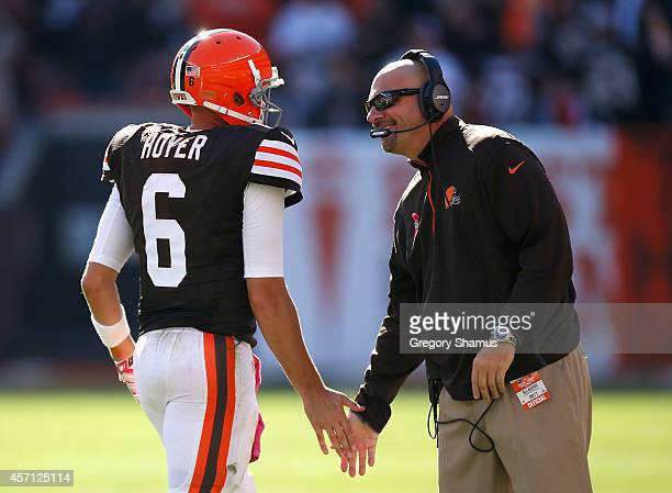 Brian Hoyer of the Cleveland Browns celebrates with head coach Mike Pettine during the fourth quarter against the Pittsburgh Steelers at FirstEnergy...