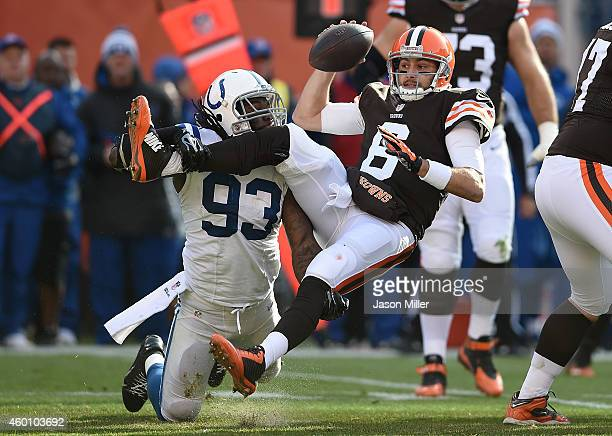 Brian Hoyer of the Cleveland Browns gets sacked by Erik Walden of the Indianapolis Colts during the first quarter at FirstEnergy Stadium on December...